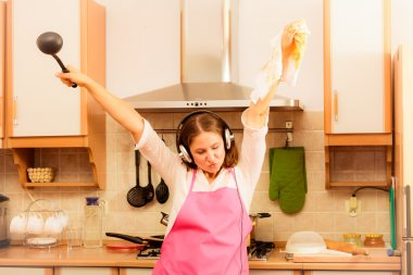 Crazy housewife cook in kitchen