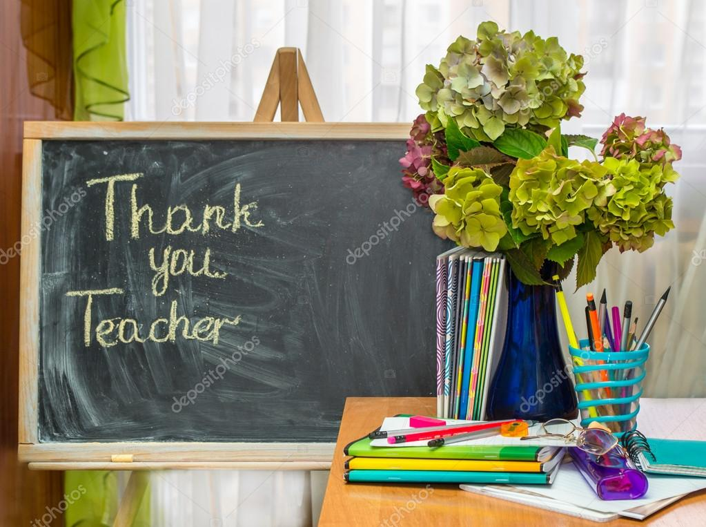 Teacher  Day. Hydrangea flowers and copybooks on the teacher's desk