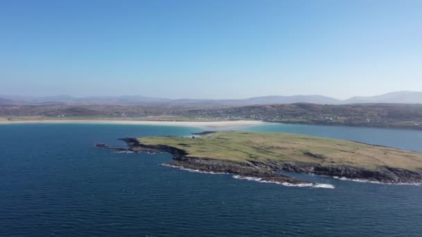Aerial view of Inishkeel Island by Portnoo next to the the awarded Narin Beach in County Donegal, Ireland - Monk building remains