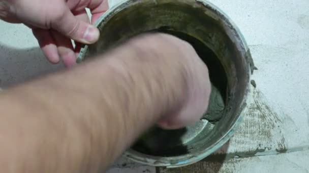 Worker mixing cement mortar
