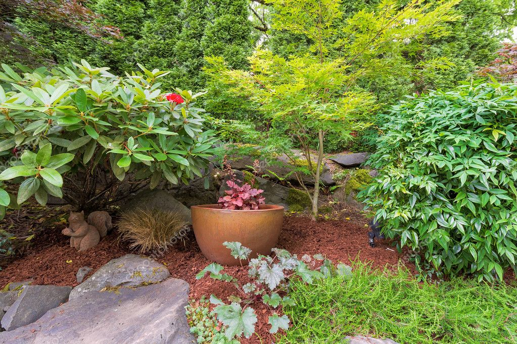 Backyard Garden Landscaping with Gold Pot