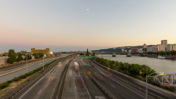 Time Lapse Movie of Long Exposure Traffic Light Trails and Moonrise in Downtown City or Portland Oregon at Sunset 1080p