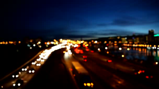 High Definition Movie of Out of Focus Bokeh of Auto Traffic on Interstate Freeway in Portland Oregon During Peak Hour against Blue Sky at Night 1080p