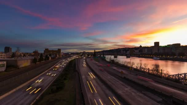 Time Lapse Movie of Long Exposure Peak Hour Fast Moving Freeway Traffic and Train Along Willamette River with Portland Oregon Downtown City Skyline at Colorful Sunset 1080p