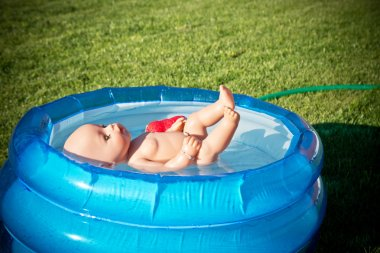 doll floating in the small pool