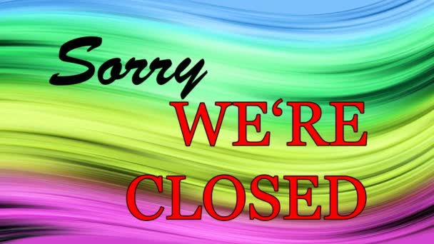 Writing SORRY  WERE CLOSED on the colored background