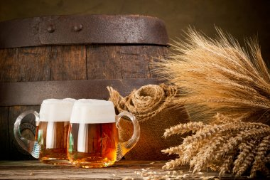 two beer glasses with wheat and barley