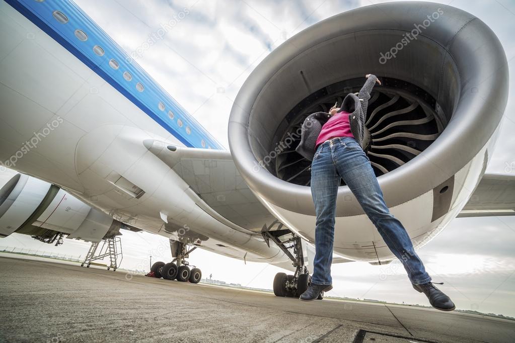 Suck into jet engine