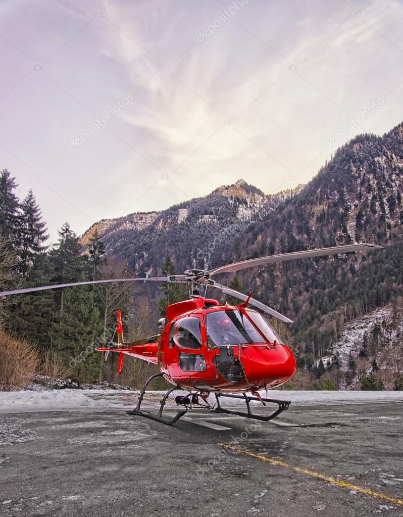Red Helicopter In Heliport At Swiss Alps 2 Stock Photo