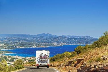 Caravan on the road at the mediterranean shore