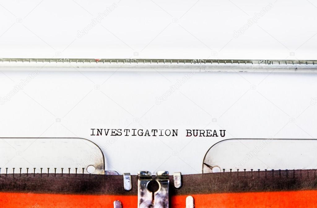 Texto de gabinete de investigação em máquina de escrever u stock