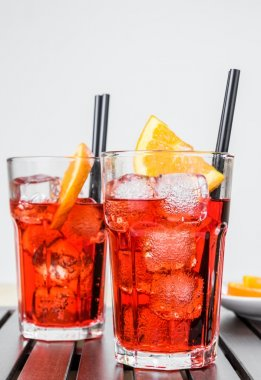 glasses of spritz aperitif aperol cocktail with orange slices and ice cubes