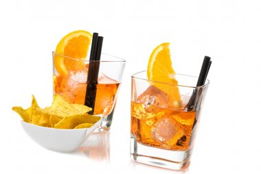two glasses of spritz aperitif aperol cocktail with orange slices and ice cubes near tacos chips