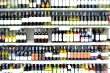 Abstract Blur or Defocus Background of Bottles of Wine on Shelf