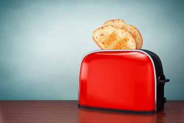 Old Style Photo. Toast popping out of Vintage Red Toaster