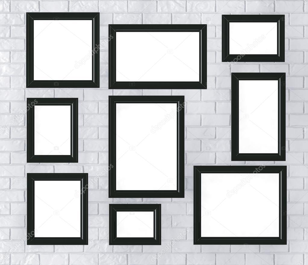Marcos negros en una pared de ladrillo — Fotos de Stock © doomu ...