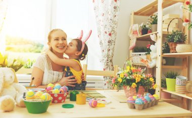 happy family celebrating Easter. mother and daughter kissing at
