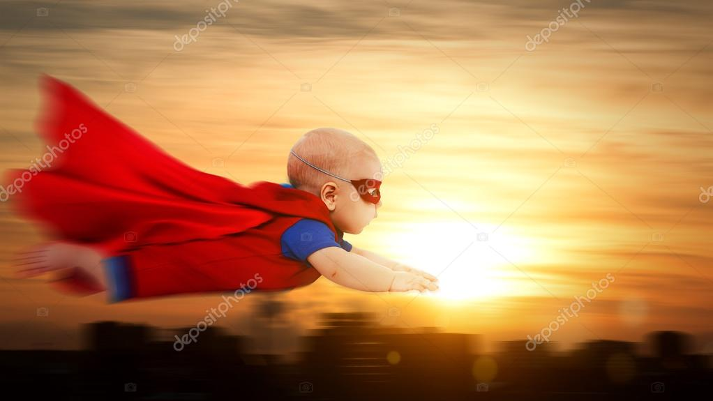 Toddler little baby superman superhero with red cape flying thro toddler little baby superman superhero with a red cape flying through sunset sky above the city photo by evgenyataman publicscrutiny Gallery