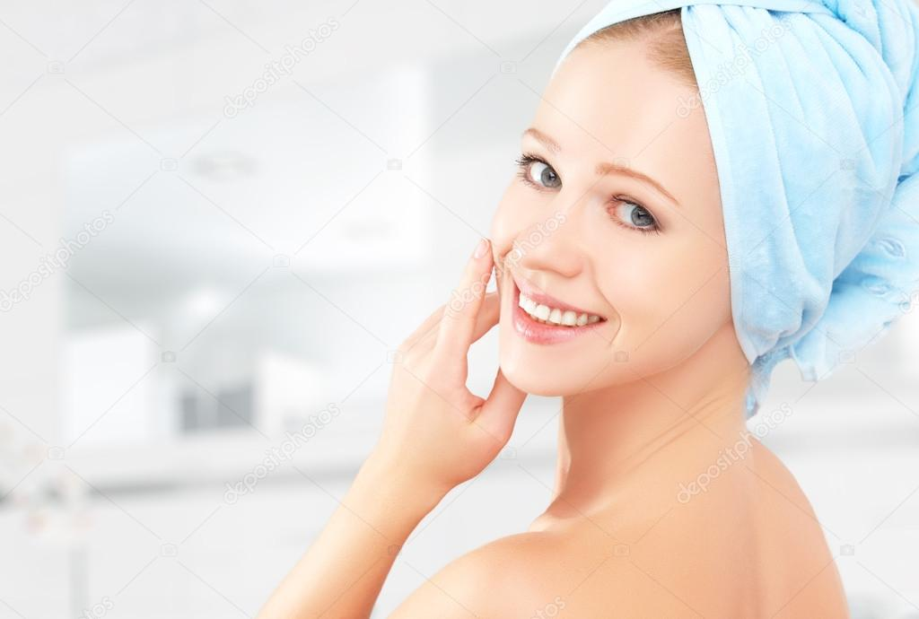 skin care. young beautiful healthy girl in towel in bathroom