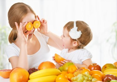happy family mother and daughter little girl, eat healthy vegeta