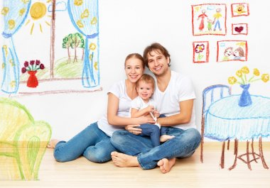 Concept : happy young family in  new apartment dream and plan in