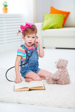 Child little girl playing doctor