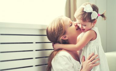 Happy loving family. mother and child playing,  kissing and hugg