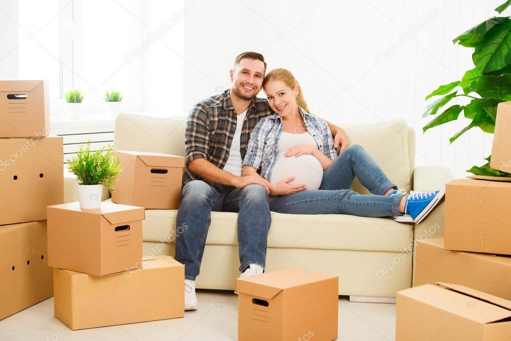 Moving to  new apartment. family pregnant wife and husband with