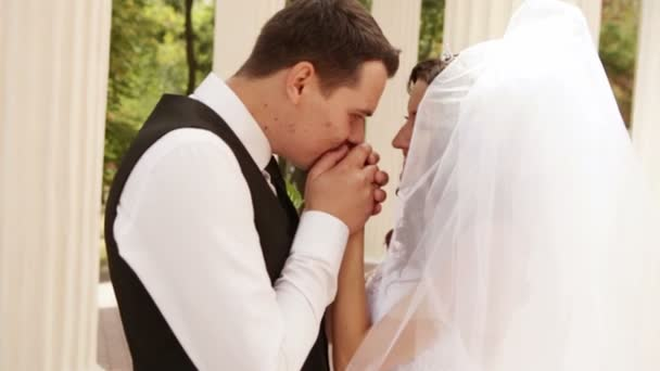Groom kisses hands bride