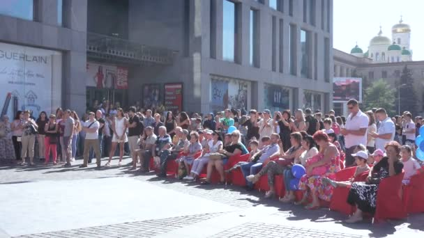 Spectators at the concert on the street