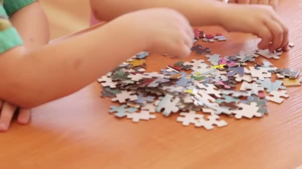 Babies  hands assemble the puzzle