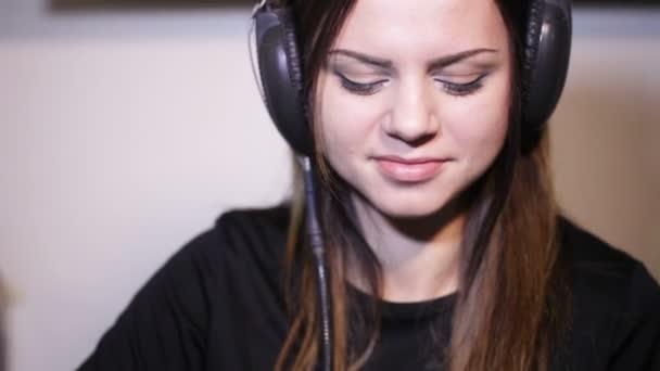 Girl in headphones smile