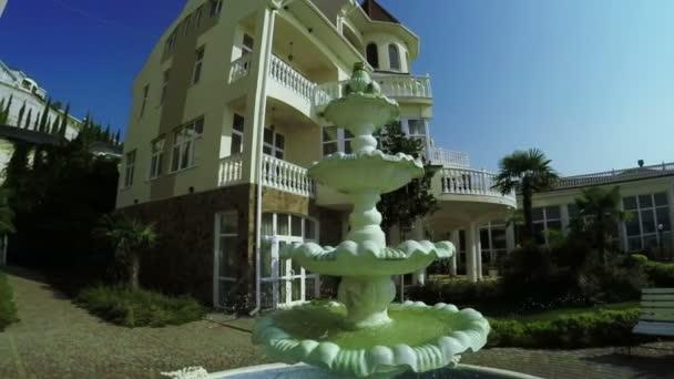 Fountain near mansion