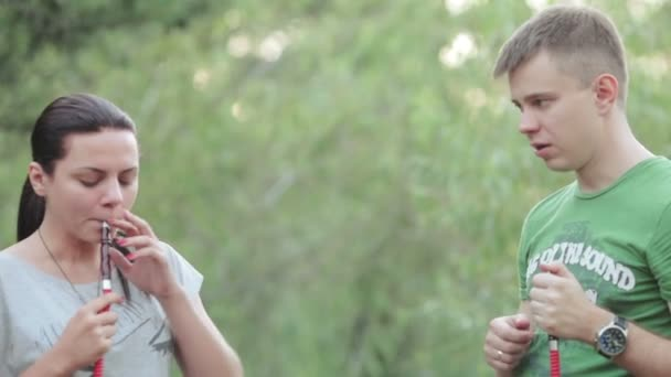 Couple smoking hookah in nature