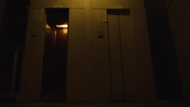 Old elevators in entrance. Stock footage. Lifts narrow doors open and close. Old narrow elevators in residential building. Two small elevators for couple of people