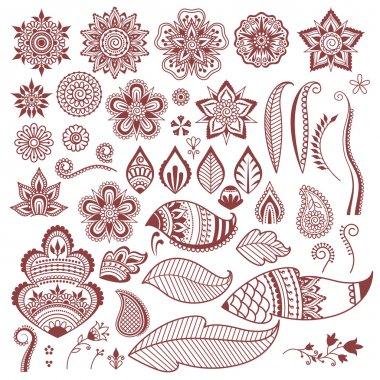 Mehndi henna tattoo flowers and leaves.