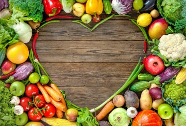 Assortment of  fresh fruist and vegetables in heart shape