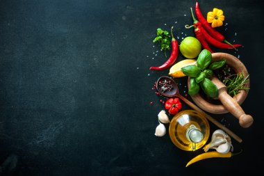 Herbs and spices on slate background