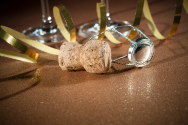 Cork from champagne bottle and two glasses