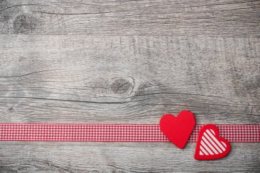 Valentines Day background with patterned hearts on old wooden stock vector