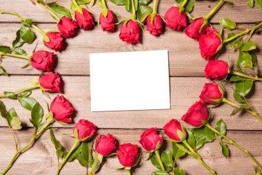 Frame of fresh roses