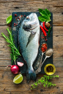 Fresh Gilt-head bream with spices and seasoning