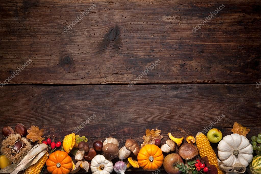 Harvest Or Thanksgiving Background With Autumnal Fruits And Gourds On A Rustic Wooden Table Photo By Alexraths