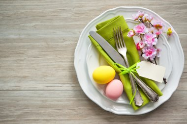 Easter table setting with spring flowers and cutlery