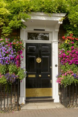 blossoming flowers and georgian entrance, Henley on Thames