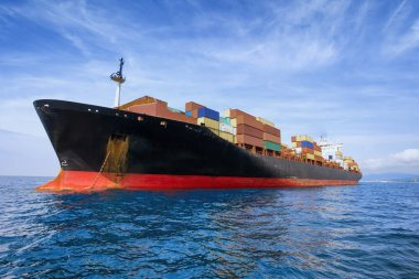 commercial cargo ship carrying containers