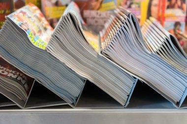 piles of magazines in the kiosk