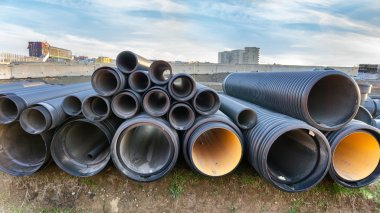 stacked pipes in construction site
