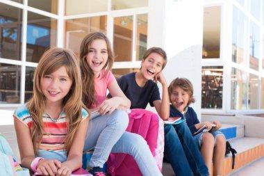 school kids sitting on stairs