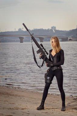 Beautiful woman with a gun